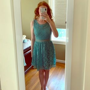 Teal lace dress with open back